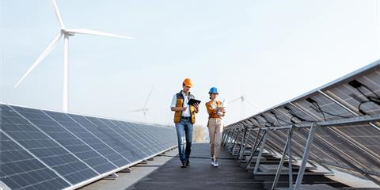 Two people talking at a solar farm