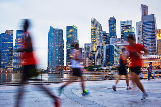 People jogging through urban environment