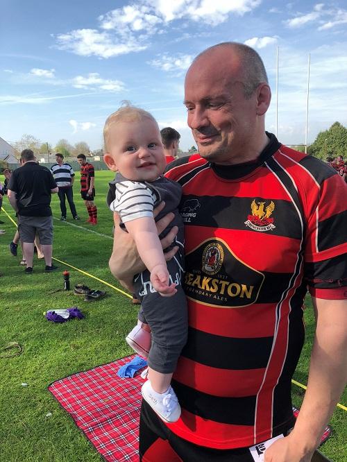 Dan Carter enjoys family time following a rugby match